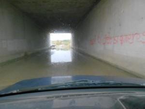 ondergelopen tunneltje naar asiel